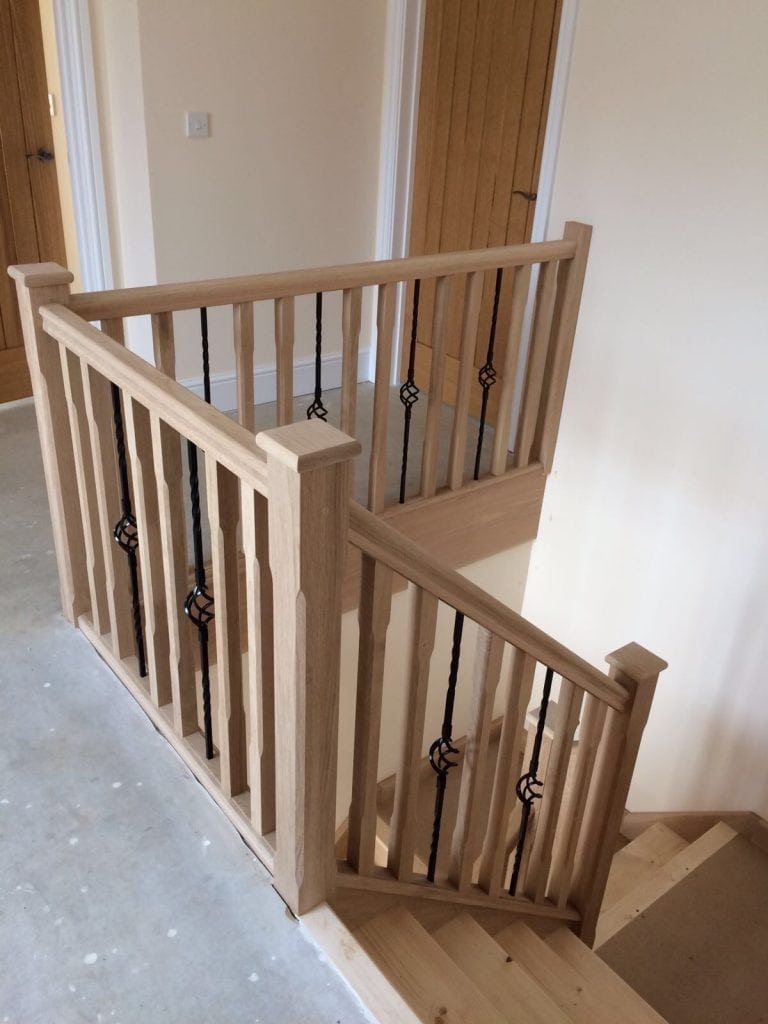 wooden staircase and metal rails