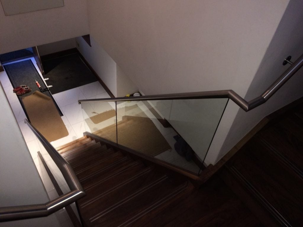 dark wood staircase and metal handrails