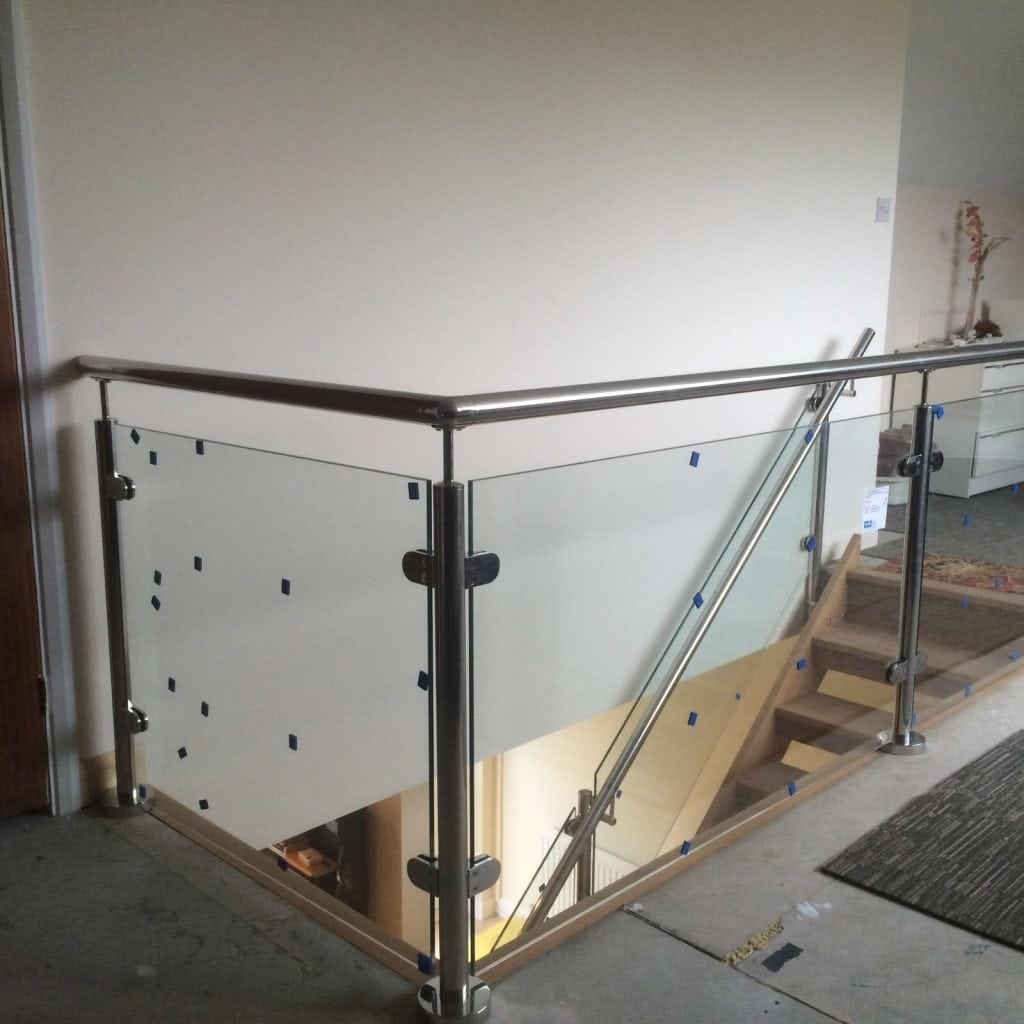 glass metal and wood staircase