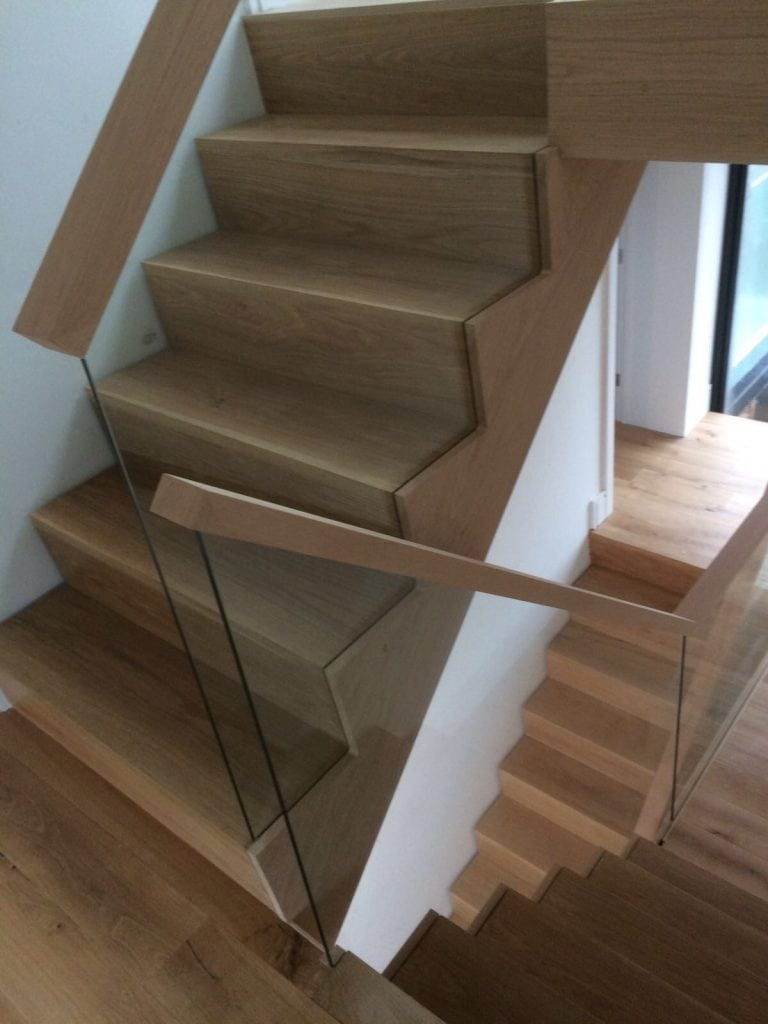 natural wood and glass staircase