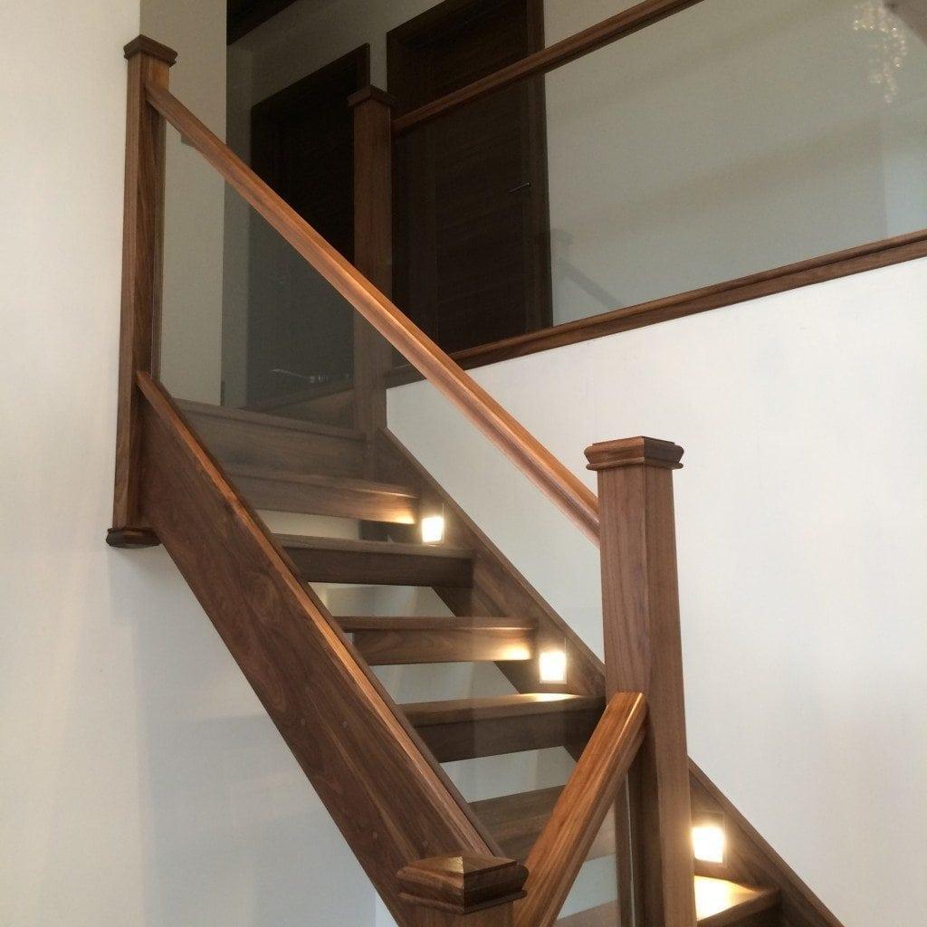 glass and dark wood stairs